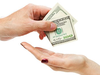 Hand Of Man Giving Hundred Dollars To Womans Hand